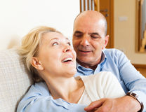 Happy mature woman smiling and hug with husband Stock Images