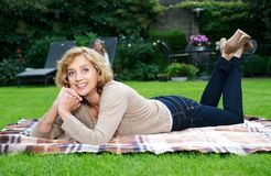 Happy mature woman smiling outdoors Stock Photo