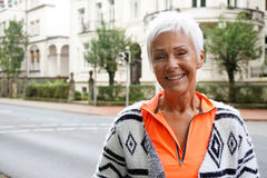 Happy mature woman on street royalty free stock photos