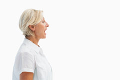 Happy mature woman talking loudly Royalty Free Stock Photos
