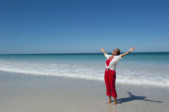 Happy Mature Woman at Tropical Beach Stock Images