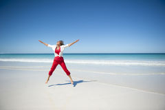 Happy Mature Woman at Tropical Beach stock photography