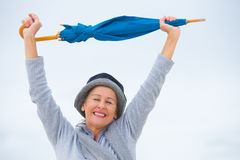 Happy mature woman with umbrella closed eyes Royalty Free Stock Photography