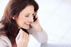 Happy mature woman using cellphone Royalty Free Stock Photography