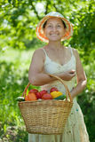 Happy mature woman with vegetables Stock Photography