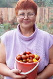 Happy mature woman with vegetables harvest Royalty Free Stock Images
