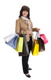 Happy mature woman walking with her shopping purchases Royalty Free Stock Image