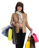 Happy mature woman walking with her shopping purchases Stock Photos