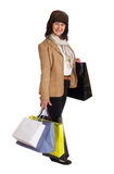 Happy mature woman walking with shopping purchases Stock Photos