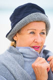 Happy Mature woman in warm jumper in cold season Stock Photos