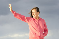 Happy mature woman waving hand Royalty Free Stock Image