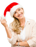 Happy mature woman wearing santa hat for christmas isolated on w Royalty Free Stock Photography