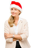 Happy mature woman wearing santa hat for christmas isolated on w Royalty Free Stock Photo