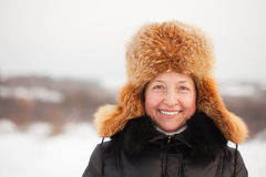 Happy mature woman in winter Stock Photo