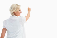 Happy mature woman writing and smiling Royalty Free Stock Photos