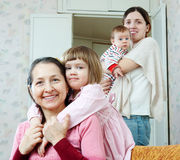 Woman and adult daughter with two childre Royalty Free Stock Image