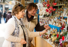 Happy mature women purchasing Christmas decorations Royalty Free Stock Photo