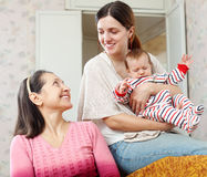 Woman talking to adult daughter with granddaughter Stock Photography