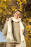 Happy matured woman in front of yellow autumn leaves Stock Images