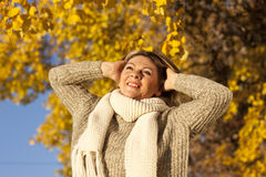 Happy matured woman in front of yellow autumn leaves Stock Image