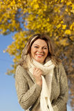 Happy matured woman in front of yellow autumn leaves Stock Photo