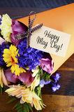 Happy May Day traditional gift of Spring Flowers. Royalty Free Stock Image
