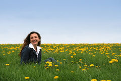 Happy in the meadow III. A happy young lady in a flowering spring field stock images