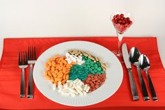 Happy Meal!. Lots of various pills in a plate ready for lunch Royalty Free Stock Images