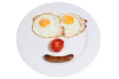 Happy Meal. English cooked breakfast ingredients arranged as a smiling face Royalty Free Stock Photos