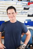 Happy Mechanic. Happy young mechanic looking at the camera royalty free stock photos