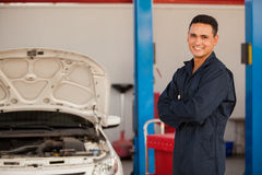 Happy mechanic at an auto shop Stock Image