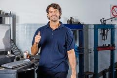 Happy Mechanic Gesturing Thumbsup Stock Photo