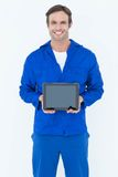 Happy mechanic holding digital tablet Stock Images
