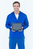 Happy mechanic holding digital tablet. Portrait of happy mechanic holding digital tablet over white background Stock Images