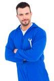Happy mechanic holding spanner on white background Royalty Free Stock Image