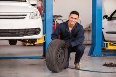 Happy mechanic loving his job Royalty Free Stock Photos