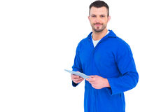 Happy mechanic pointing on digital tablet. Portrait of happy mechanic pointing on digital tablet on white background Stock Photography