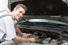Happy mechanic repairing Stock Image