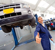 Happy mechanic with thumbs-up Stock Photos