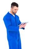 Happy mechanic using digital tablet. On white background Stock Photo
