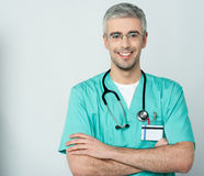 Happy medical doctor with arms crossed Stock Photo