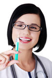 Happy medical doctor or nurse with syringe Royalty Free Stock Photos