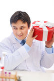 Happy medical doctor shaking present box royalty free stock photos