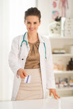 Happy medical doctor woman giving business card Stock Photography