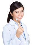 Happy medical doctor woman hold toothbrush Stock Images