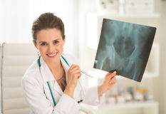 Happy medical doctor woman holding fluorography Stock Image