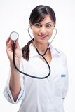 Happy medical doctor woman holding stethoscope Royalty Free Stock Images