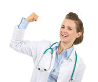Happy medical doctor woman showing biceps Stock Image