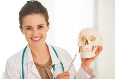Happy medical doctor woman showing human skull Stock Photography