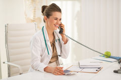 Happy medical doctor woman talking phone Royalty Free Stock Photo